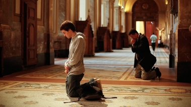 young adult praying in church